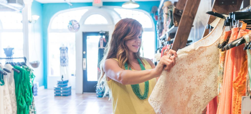 Woman Shops for Clothes at a Fashionable Retail Boutique