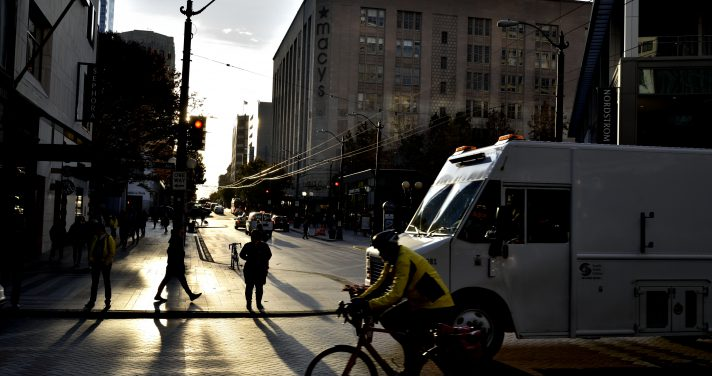 Man riding a bike in a city street