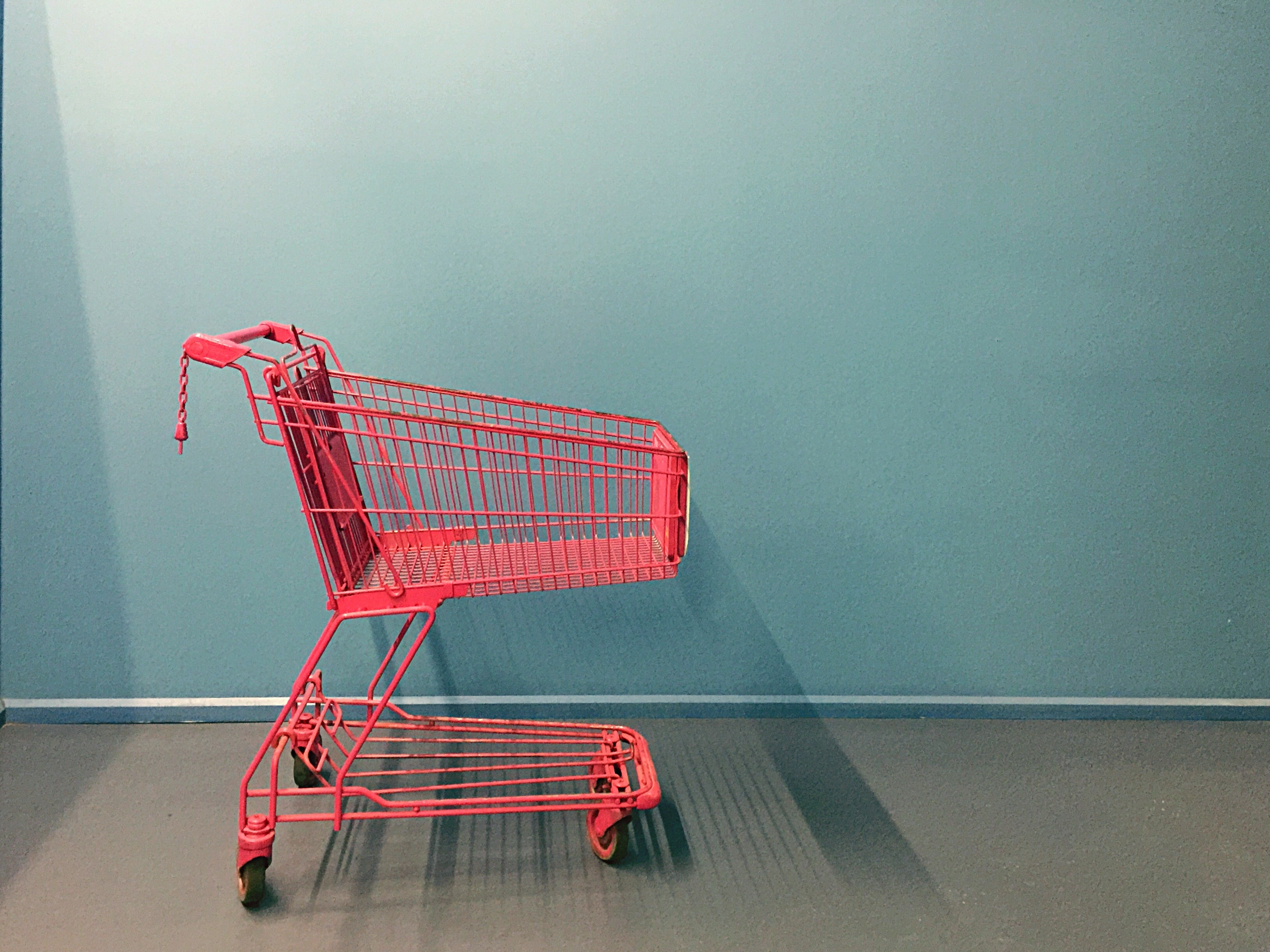 Abandoned Shopping Trolley Against The Wall